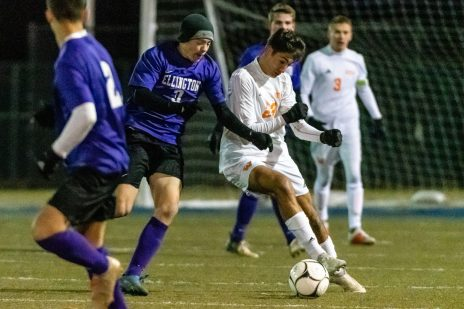 Watertown's Anthony Longo #23 uses his body holding off Ellington's John Chamberland #3 during the Boys Soccer Class M Semifinal game between Ellington and Watertown at Municipal Stadium in Waterbury on Wednesday. Bill Shettle Republican-American