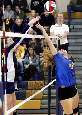 #11 Mackenzie Sirowich of Seymour tries to block a shot by #14 Katherine Anderson of Weston during the CIAC Class M volleyball championship game in East Haven Saturday. Steven Valenti Republican-American