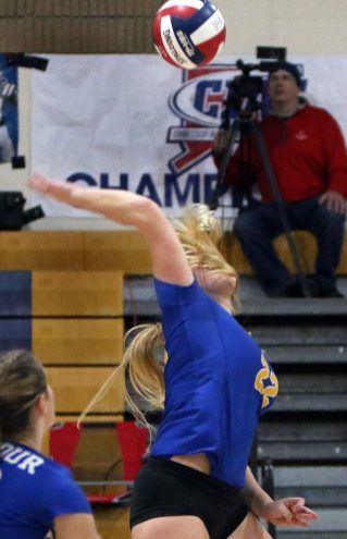 #22 Kolby Sirowich of Seymour High sets to spike a ball against Weston during the CIAC Class M volleyball championship game in East Haven Saturday. Steven Valenti Republican-American