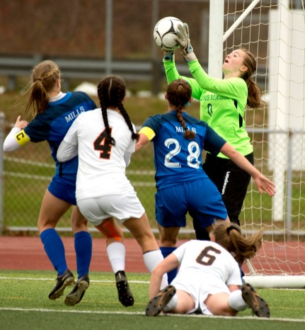 Lewis Mills' goal keeper Resmije Bylykbashi (0) makes a save during their Class M soccer championship game with Plainfield Sunday at West Haven High School. Jim Shannon Republican American