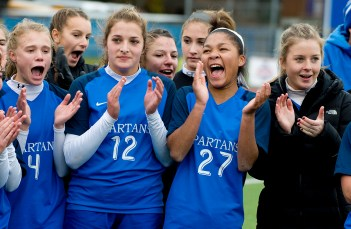 Lewis Mills' players, including Morgan Sokol (4), Victoria Fleming (12) and Jazzy Sztyler-Magee (27), celebrate their 2-1 overtime win over Plainfield to capture the Class M soccer championship Sunday at West Haven High School. Jim Shannon Republican American