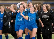 Lewis Mills' players, Hannah Anderson (28) and Abby Mills (23) acknowledge their fans as they celebrate their 2-1 overtime win over Plainfield to capture the Class M soccer championship Sunday at West Haven High School. Jim Shannon Republican American