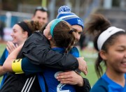 Lewis Mills' head coach Jared Sheikh gives a congratulatory to tri-captain Hannah Anderson (28) as they celebrate their 2-1 overtime victory over Plainfield to capture the Class M soccer championship Sunday at West Haven High School. Jim Shannon Republican American