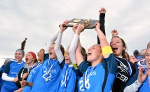 Lewis Mills' tri- captains Grace Kryzanski (22),Morgan Sokol (4) and Hannah Anderson (28) , hoist the state championship trophy as they celebrate their 2-1 overtime win over Plainfield to capture the Class M soccer championship Sunday at West Haven High School. Jim Shannon Republican American