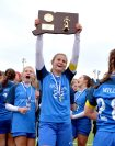 Lewis Mills' tri-captains Grace Kryzanski (22), hoists the state championship trophy as the team celebrate their 2-1 overtime win over Plainfield to capture the Class M soccer championship Sunday at West Haven High School. Jim Shannon Republican American