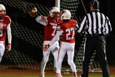 Pomperaug quarterback Troy Harwell #7 celebrates his touchdown run in the end zone with teammate Cole Adami #27 during the regular season finale between Notre Dame of Fairfield and Pomperaug at Pomperaug High School in Southbury on Wednesday. Bill Shettle Republican-American