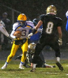 Seymour High School's Jonathan Dumas tries to run the ball past Woodland High School's Jason Palmieri during the game at Woodland High School on Wednesday. Emily J. Reynolds. Republican-American