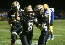 Woodland High School's Jason Palmieri celebrates a touchdown with teammate Mike Farina during the game at Woodland High School against Seymour High School on Wednesday. Emily J. Reynolds. Republican-American