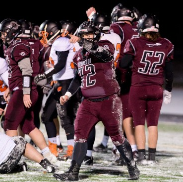 Torrington's Zach Sweeney (72) fires up the crowd after Torrington scored a touchdown against Watertown during their annual match--up Wednesday at Torrington High School. Jim Shannon Republican American