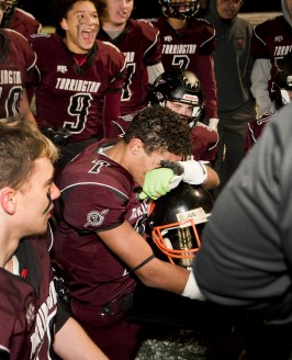 "Torrington senior John Rocha (7) gets emotional while holding ""The Helmet"" trophy following their 37-20 win over Watertown Wednesday at Torrington High School. Jim Shannon Republican American"