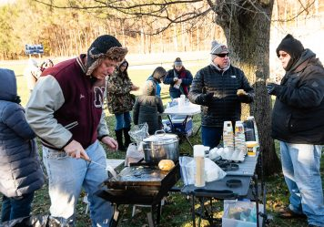 Naugatuck alumn Jim Goggin class of 1981 cooks up some eggs very early before the NVL clash of unbeatens and the annual Thanksgiving Day game between Naugatuck and Ansonia at Jarvis Stadium at the Nolan Field Athletic Complex in Ansonia on Thursday. Bill Shettle Republican-American