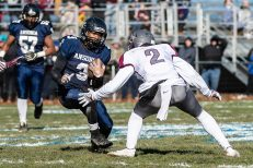 Ansonia's Shykeem Harmon #3 runs with the ball looking to get by Naugatuck's Paul Marsh #2 during a NVL clash of unbeatens and the annual Thanksgiving Day game between Naugatuck and Ansonia at Jarvis Stadium at the Nolan Field Athletic Complex in Ansonia on Thursday. Bill Shettle Republican-American
