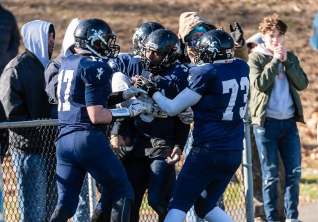 Ansonia's Tyler Cafaro #17, left and Ansonia's Nicholas DiPalma #73, right, celebrate with Ansonia's Shykeem Harmon #3, center, scoring of a touchdown very late in the fourth quarter during a NVL clash of unbeatens and the annual Thanksgiving Day game between Naugatuck and Ansonia at Jarvis Stadium at the Nolan Field Athletic Complex in Ansonia on Thursday. Bill Shettle Republican-American
