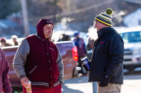 Former Naugatuck assistant coach Chuck Rek, left and former Naugatuck mascot Ray Rossi tailgate in the cold very early before the big NVL clash of unbeatens and the annual Thanksgiving Day game between Naugatuck and Ansonia at Jarvis Stadium at the Nolan Field Athletic Complex in Ansonia on Thursday. Bill Shettle Republican-American