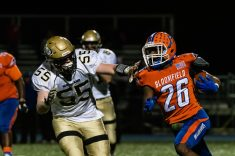 Woodland's Joe Shea #55 chases down Bloomfield's Shakur Hill #26 running with the ball during the CIAC State Championships Class S Quarterfinal game between Woodland and Bloomfield at Bloomfield High School in Bloomfield on Tuesday. Bill Shettle Republican-American