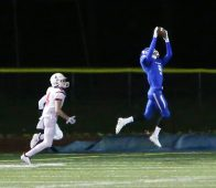Southington High School's William Downes intercepts a pass in front of Fairfield Prep's Finn Duran during the Class LL football quarterfinal game in Southington on Tuesday. Emily J. Reynolds. Republican-American