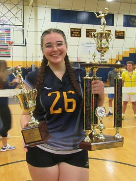 MVP Hannah West of Kennedy with Team Trophy and MVP Trophy