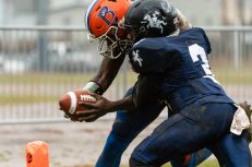Ansonia's Shykeem Harmon #3 tries to prevent Bloomfield's Anthony Simpson #3 from crossing the goal line during the Class S Semi-final game between Bloomfield and Ansonia at Ansonia High School in Ansonia on Sunday. Bloomfield held on to beat Ansonia 26-19 and advances to the Class S Championship game next week. Bill Shettle Republican-American