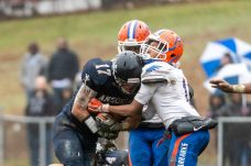 Ansonia's Tyler Cafaro #17 tries to run through the defense of Bloomfield's Alfonzo Stokes #1 during the Class S Semi-final game between Bloomfield and Ansonia at Ansonia High School in Ansonia on Sunday. Bloomfield held on to beat Ansonia 26-19 and advances to the Class S Championship game next week. Bill Shettle Republican-American