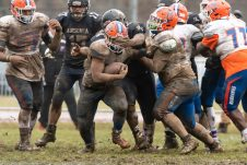 Ansonia's Terjuan Burney #54 puts his hands in front to stop Bloomfield's Ky'Juon Butler #45, as he runs with the ball during the Class S Semi-final game between Bloomfield and Ansonia at Ansonia High School in Ansonia on Sunday. Bloomfield held on to beat Ansonia 26-19 and advances to the Class S Championship game next week. Bill Shettle Republican-American