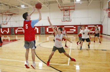 Wamogo's Reid Turturo (#5) gets a shot up as Cole Higgins defends during pre-season drills in the newly renovated gym Monday. Michael Kabelka Republican-American