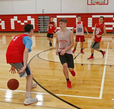 Wamogo's Reid Turturo (#5) dribbles during pre-season drills in the newly renovated gym Monday. Michael Kabelka Republican-American