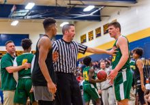 Official Tim Lynch, center gets in between WCA center Marquan Watson #22, left and Holy Cross' Jack Greene #33 as they exchange words during the annual Waterbury Boys Basketball Jamboree at Kennedy High School in Waterbury on Sunday. Bill Shettle Republican-American