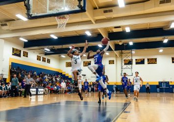 Crosby's Tyler Spears #23 drives down the middle for a slam dunk against Chase Collegiate's Rafael Mahario #5 during the annual Waterbury Boys Basketball Jamboree at Kennedy High School in Waterbury on Sunday. Bill Shettle Republican-American