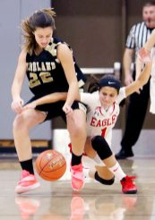 #22 Adra Bojka of Woodland High and #1 Emiah Soto of Wolcott High battle for the loose ball during 1st quarter NVL basketball action in Wolcott Monday. Steven Valenti Republican-American