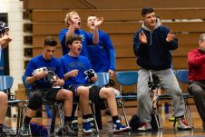 Nonnewaug players cheer on their teammates from the sidelines during a wrestling match between Northwestern Regional and Nonnewaug at Nonnewaug High School in Woodbury on Wednesday. Bill Shettle Republican-American