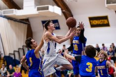 Litchfield's Tripp Melk #4 drives down the lane against Hosatonic defenders Zachary Ongley #5, Evan Miller #10, and Charlie Kaufman #3 during a BL Boys basketball game between Housatonic Valley ad Litchfield at Litchfield High School in Litchfield on Thursday. Bill Shettle Republican-American