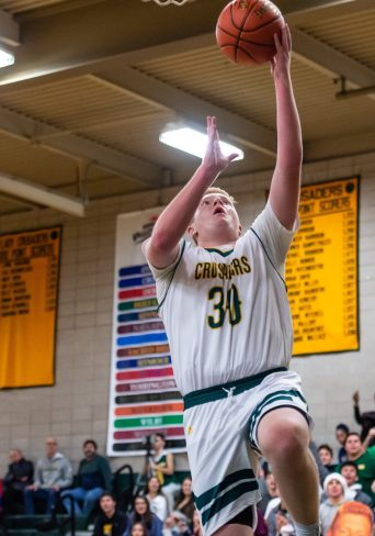 Holy Cross' Kyle Moser lays the ball up for an easy basket during the NVL Boys Basketball opener between Seymour and Holy Cross at Holy Cross High School in Waterbury on Friday. Bill Shettle Republican-American