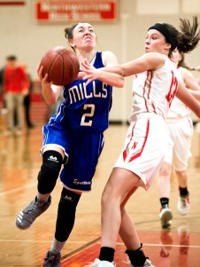 Lewis Mills' Abby Mills (2) gets fouled by Northwestern's Emma Propfe (13) while driving to the basket during their game Tuesday at Northwestern Regional High School. Jim Shannon Republican American