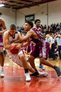 Torrington's Kevin Dixon #22, left and Naugatuck's Robert Sanders #23 battle for control of the ball down low during a NVL Boys Basketball game between Naugatuck and Torrington at Torrington High School in Torrington on Thursday. Torrington held on to win in a close one 47-46 over Naugatuck. Bill Shettle Republican-American