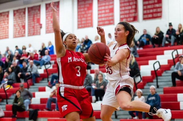Pomperaug's Madison Villa #35 hustles to save the ball in front of Masuk's Brianna Craig #3 looking on during a SWC Girls Basketball game between Masuk and Pomperaug at Pomperaug High School in Southbury on Friday. Bill Shettle Republican-American
