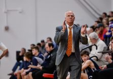 Wamogo head coach Gregg Hunt looks up at the scoreboard and the big lead and applauds the play of his players during a BL basketball game in the Litchfield Hills Holiday Claasic between Shepaug and Wamogo at Wamogo High School in Litchfield on Thursday. Bill Shettle Republican-American
