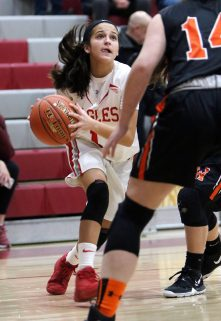 #1 Emiyah Soto of Wolcott High drives against #14 Alyssa Santangeli of Watertown High during basketball action in Wolcott Thursday. Steven Valenti Republican-American