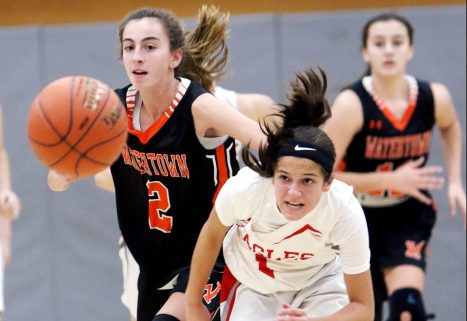 #1 Emiyah Soto of Wolcott High and #2 Kristina Kyle of Watertown High chase down the loose ball during basketball action in Wolcott Thursday. Steven Valenti Republican-American