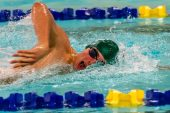 Holy Cross swimmer Sam Mason competes in the Mens 100 yard Freestyle final during a NVL Swim meet between Hand and Holy Cross at Kennedy High School in Waterbury on Friday. Bill Shettle Republican-American