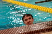 Holy Cross swimmer John Tucker looks at his time as he won the Men's 500 yard Freestyle during a NVL Swim meet between Hand and Holy Cross at Kennedy High School in Waterbury on Friday. Bill Shettle Republican-American