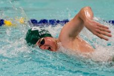 Holy Cross swimmer Derek Fantano competes in the Men's 400 Yard Freestyle Relay final during a NVL Swim meet between Hand and Holy Cross at Kennedy High School in Waterbury on Friday. Bill Shettle Republican-American