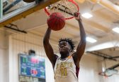 Sacred Heart's Jamaal Waters #11 dunks the ball for an easy basket during a non-league intersectional basketball game betwwen Weaver and Sacred Heart at Sacred Heart High School in Waterbury on Friday. Bill Shettle Republican-American