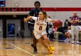 Sacred Heart's Aamya Rivera #0 dribbles with the ball while holding off Brooklyn's Zanobia Graham #5, during a non-league girls basketball game between Brooklyn Democracy Academy and Sacred Heart in the Mustapha Heron Holiday Tournament at Crosby High School in Waterbury on Saturday. Bill Shettle Republican-American