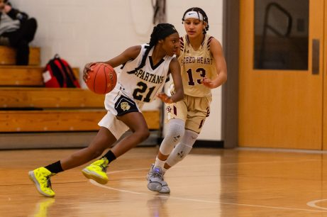 WCA's Jonna Pierre #21 drives to the basket against Sacred Heart's Mikayla Mobley #13 defending during a NVL Girls Basketball game between Sacred Heart and WCA at the Waterbury Career Academy in Waterbury on Thursday. Sacred Heart ending up beating a pesky WCA team 43-31. Bill Shettle Republican-American