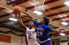 Torrington's Tyreek Davis #2 drives to the basket against Crosby's Tyler Spears #23 defending during a NVL Boys Basketball game between Crosby and Torrington at Torrington High School in Torrington on Wednesday. Bill Shettle Republican-American