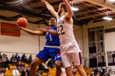 Crosby's Justin Davis #1 drives to the basket against Torrington's Kevin Dixon #22 during a NVL Boys Basketball game between Crosby and Torrington at Torrington High School in Torrington on Wednesday. Bill Shettle Republican-American