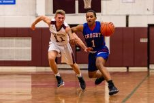 Crosby's Justin Davis #1 controls the ball in front of Torrington's TJ Callabrese #11 late in the game during a NVL Boys Basketball game between Crosby and Torrington at Torrington High School in Torrington on Wednesday. Bill Shettle Republican-American