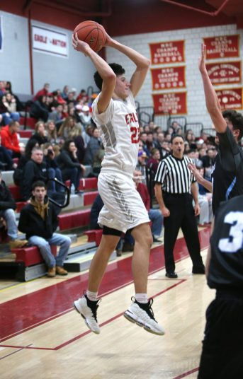 Wolcott High School's Elmin Redzepagic goes up for a shot during the varsity basketball game in Wolcott against Oxford High School on Wednesday night. Emily J. Reynolds. Republican-American