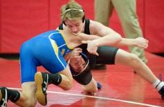 Pomperaug's Michael Carpenter pinned Newtown's James Tibolla in 2:22 during their match in the 113 lb. class during their meet Thursday at Pomperaug High School in Southbury. Jim Shannon Republican American