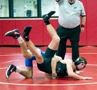 Pomperaug's Aidan Gilchrist quickly gets taken down my Newtown's Nikolas Accousti as they compete in the 138 lb. class during their meet Thursday at Pomperaug High School in Southbury. Accousti pinned Gilchrist in :55 to win the match. Jim Shannon Republican American